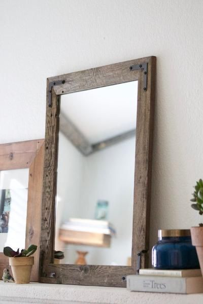 "What a lovely accent piece for your home. Our mirrors are designed and handcrafted in our home woodshop. All orders require 3-4 business days to ship. ___________________________________Dimensions: •20"" width x 24"" height ••• 24"" width x 20"" height •Can hang in either direction •Frame approximately 2"" thickness •Mirror Glass - 16""W x 20""H (Measurements are approximate)____________________________________Details: -built with reclaimed wood-1/4"" qua..."