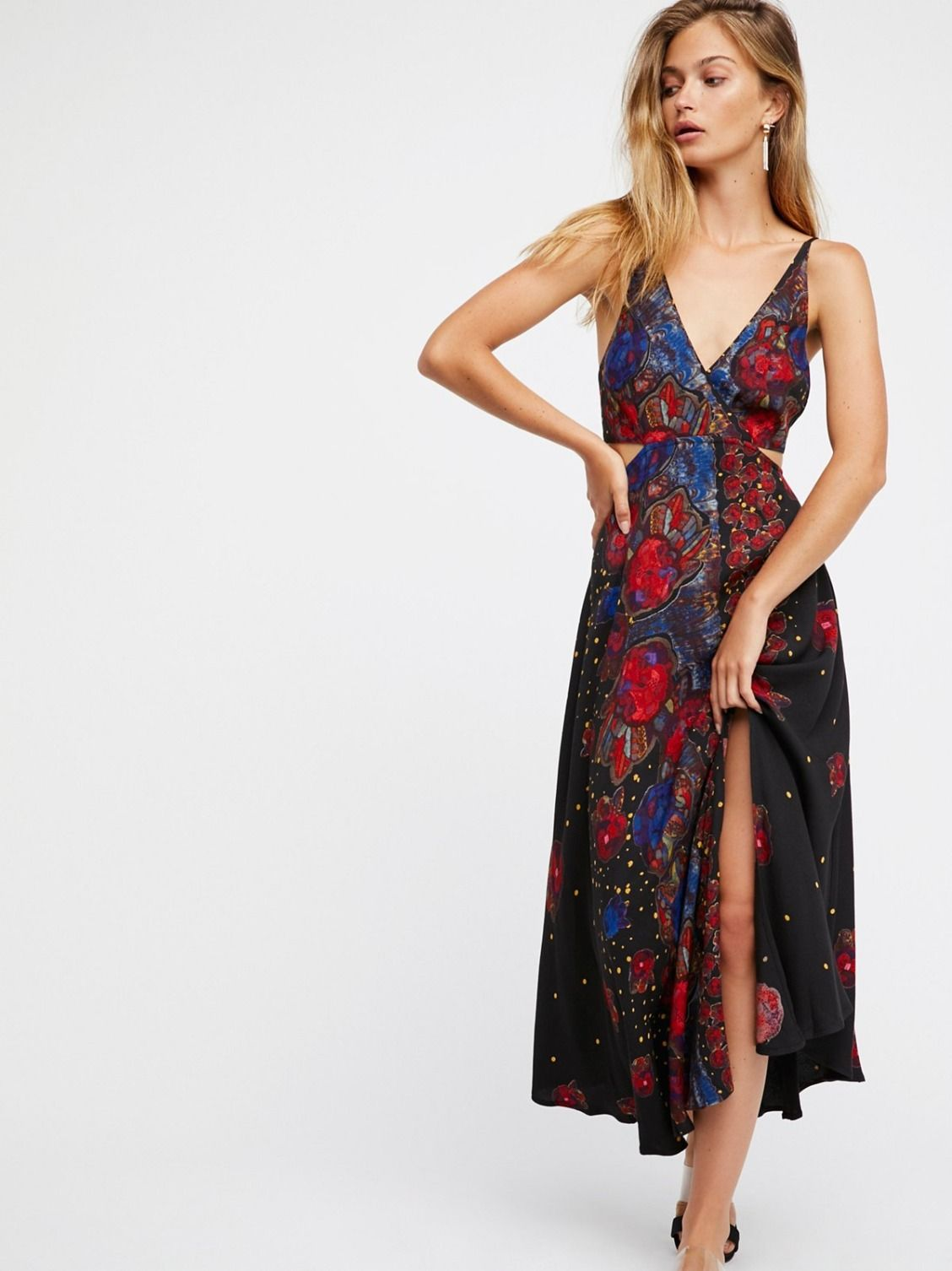 Feelin' Good Midi | Mixed print midi dress featuring skin baring side cutout details. * Front slit * Wrapped design at the bust with side button closures * Partially lined * Adjustable straps * Hidden side zipper closure