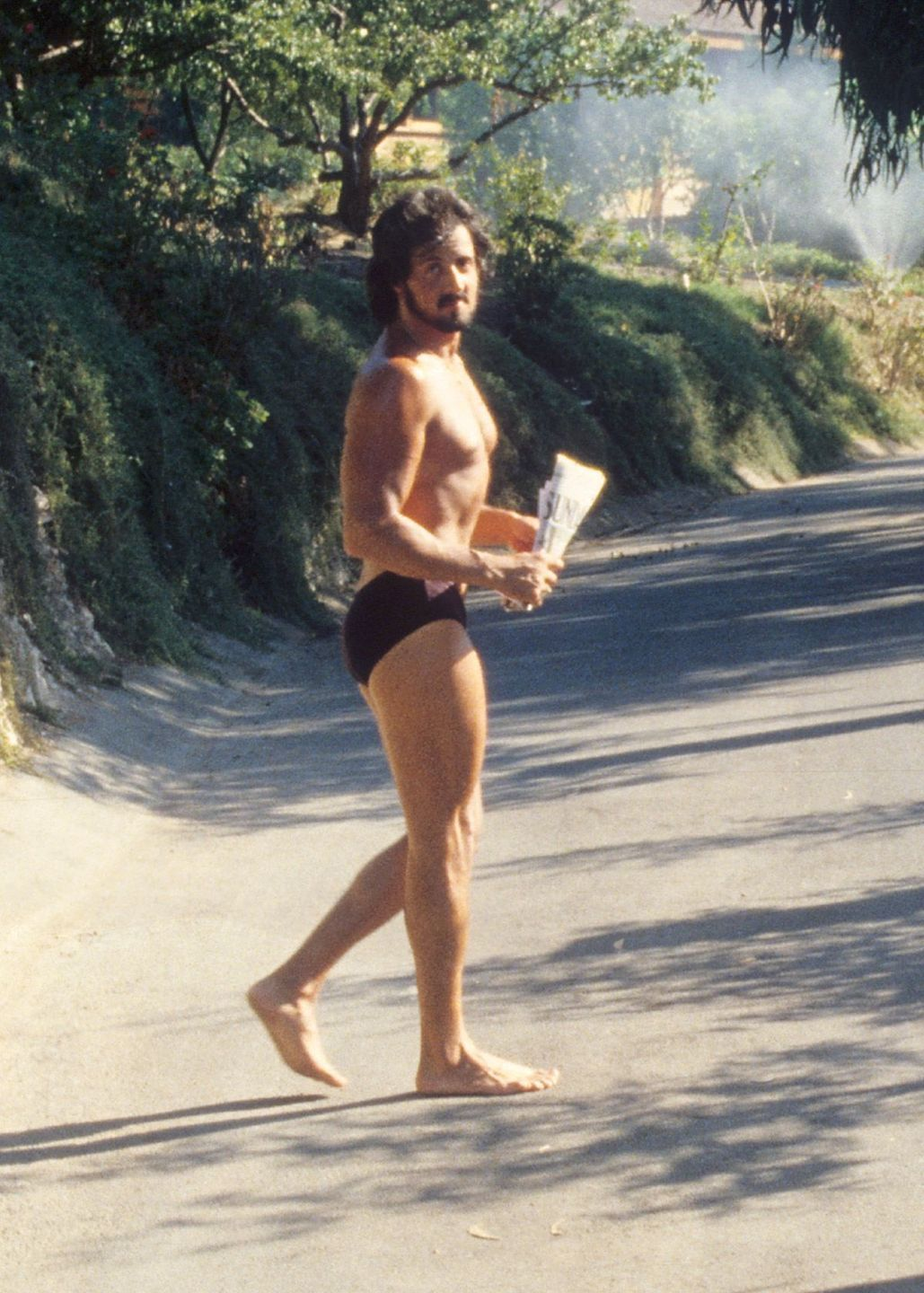 1979: Sylvester Stallone retrieves his morning paper in his skivvies