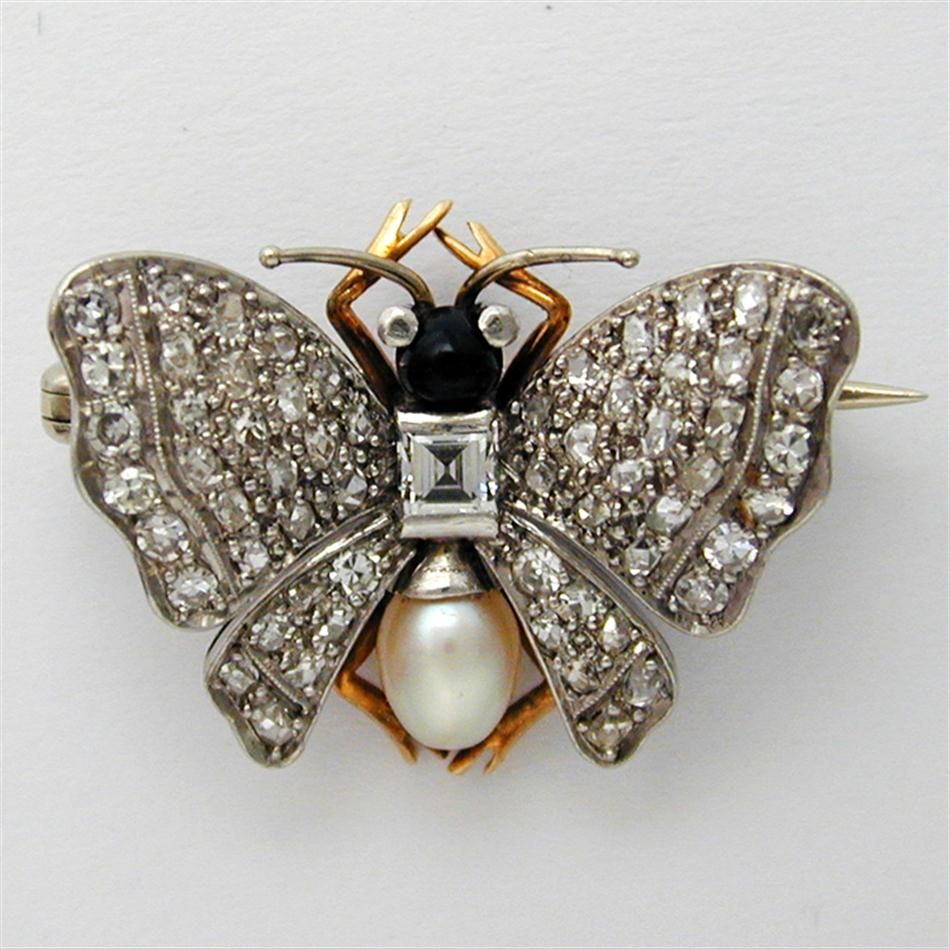 AN ART DECO ONYX  PEARL AND DIAMOND BUTTERFLY BROOCH, ca 1920