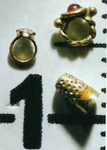 Queen Titania's diamond and ruby ring set in gold and thimble