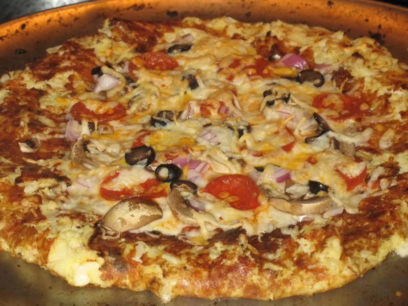 Cauliflower Cheese Stuffed Crust Pizza 1 cup cooked, riced cauliflower* 1 egg 1 cup mozzarella cheese 1/2 tsp fennel 1 tsp oregano 2 tsp par...