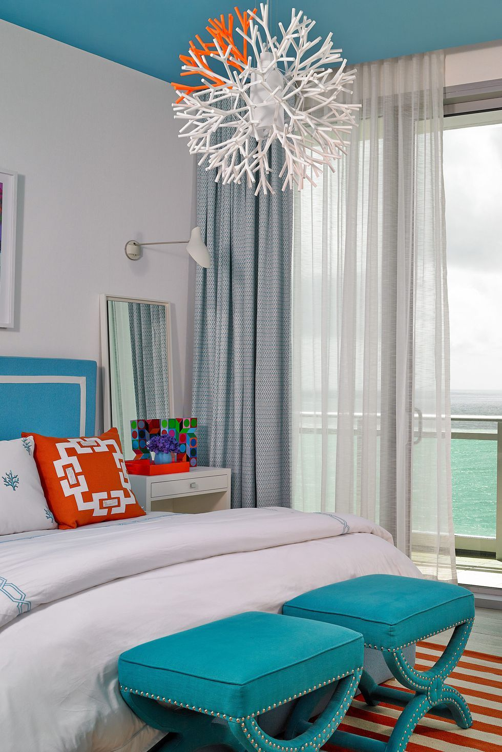 Standout colors collide and complement in a bedroom