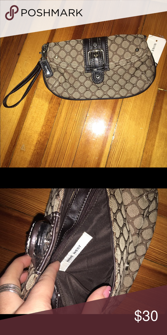 BRAND NEW Nine West Wristlet Brand New never used. Material is Fabric other than the middle clasp and the inside is spacious with a zipper pouch attached! Nine West Bags Clutches & Wristlets