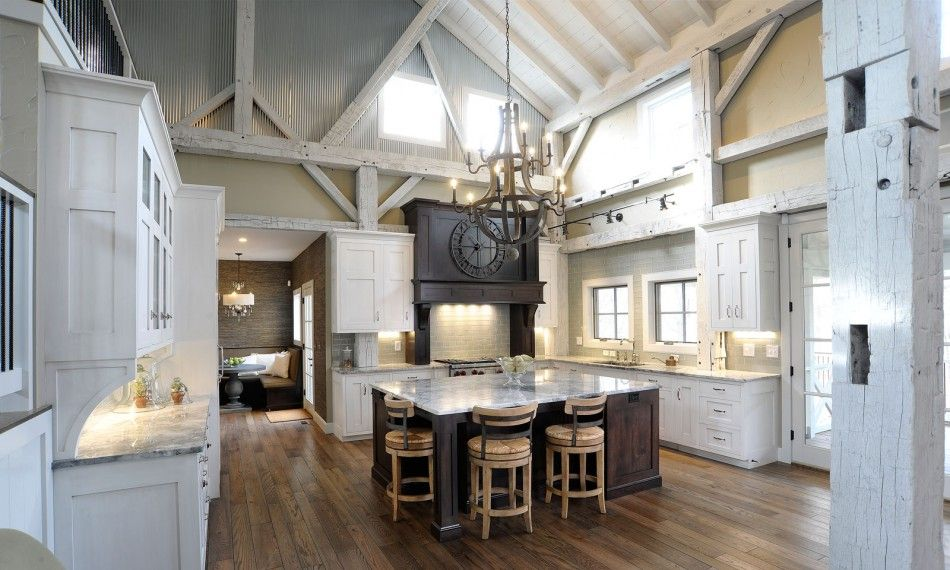 Interior white cabinet on the wooden floor pole barn for Barn style kitchen cabinets