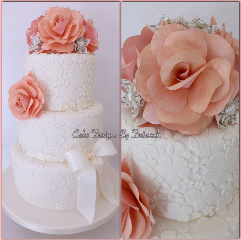 Beautiful Ivory Wedding Cake with hand made Paper Flowers                              https://www.facebook.com/CakeDesignsByDeborah