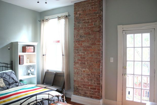 Exposed brick chimney in the bedroom.