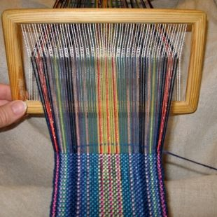 Semi-rigid heddle: This little frame loom has Tex-Solv heddles for easy threading.  It's especially suited to weaving warp-faced bands. (I just bought one and I am really excited to try some inkle patterns on it!)