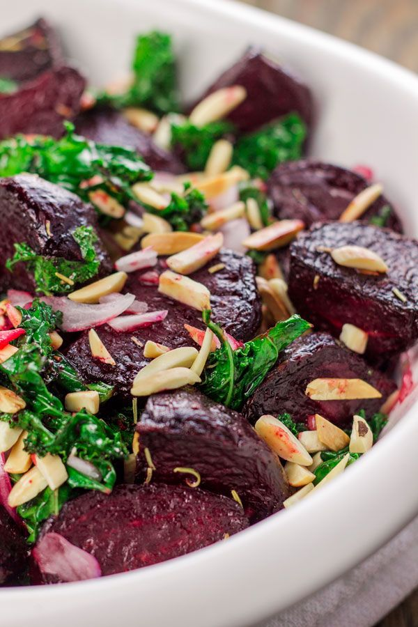 All star Mediterranean roasted beet salad with crispy kale and slivered almonds. A simple lemon-honey vinaigrette with a hint of piney rosemary brings it all together! Vegan and Gluten Free.