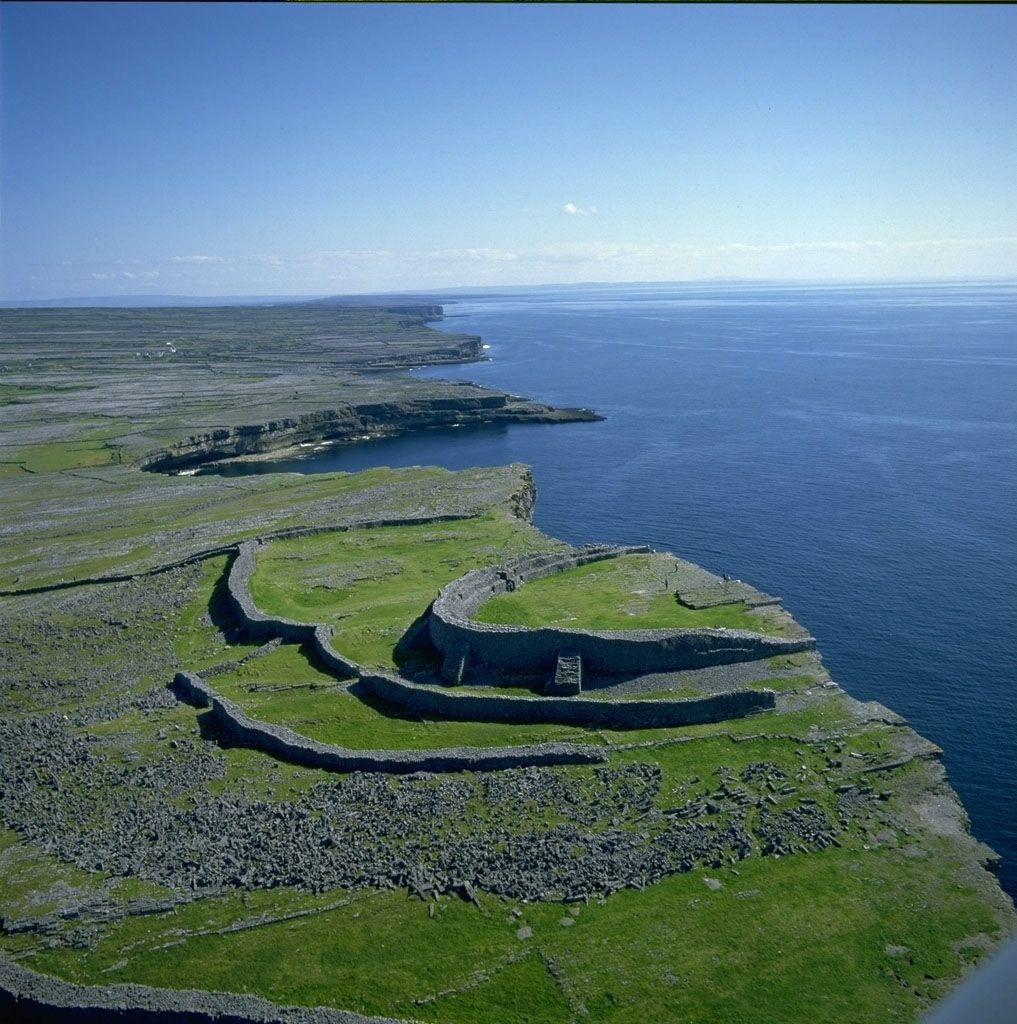 Dun Aengus - prehistoric fort at the edge of an 100 meter high cliff. The first construction goes back to 1100 BC; around 500 BC, the triple wall defenses were probably built along the western side of fort. Ireland [1000x1000]