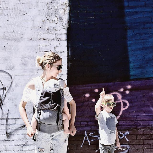 The Charcoal Juno Carrier Toning Perfectly With That Complimentary Wall Art Ergonomic Baby Carrier Juno Carriers