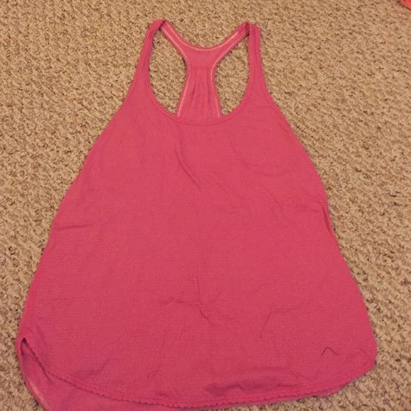 Lululemon tank Lululemon yoga tank. Cool racerback. Dark pink, worn but still in good condition. Light and great to wear over a sports bra! Loose fitting lululemon athletica Tops Tank Tops