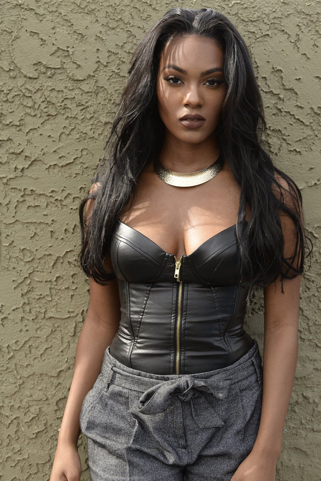 A Long, Black Wig, Tapered, With Flicked Tips