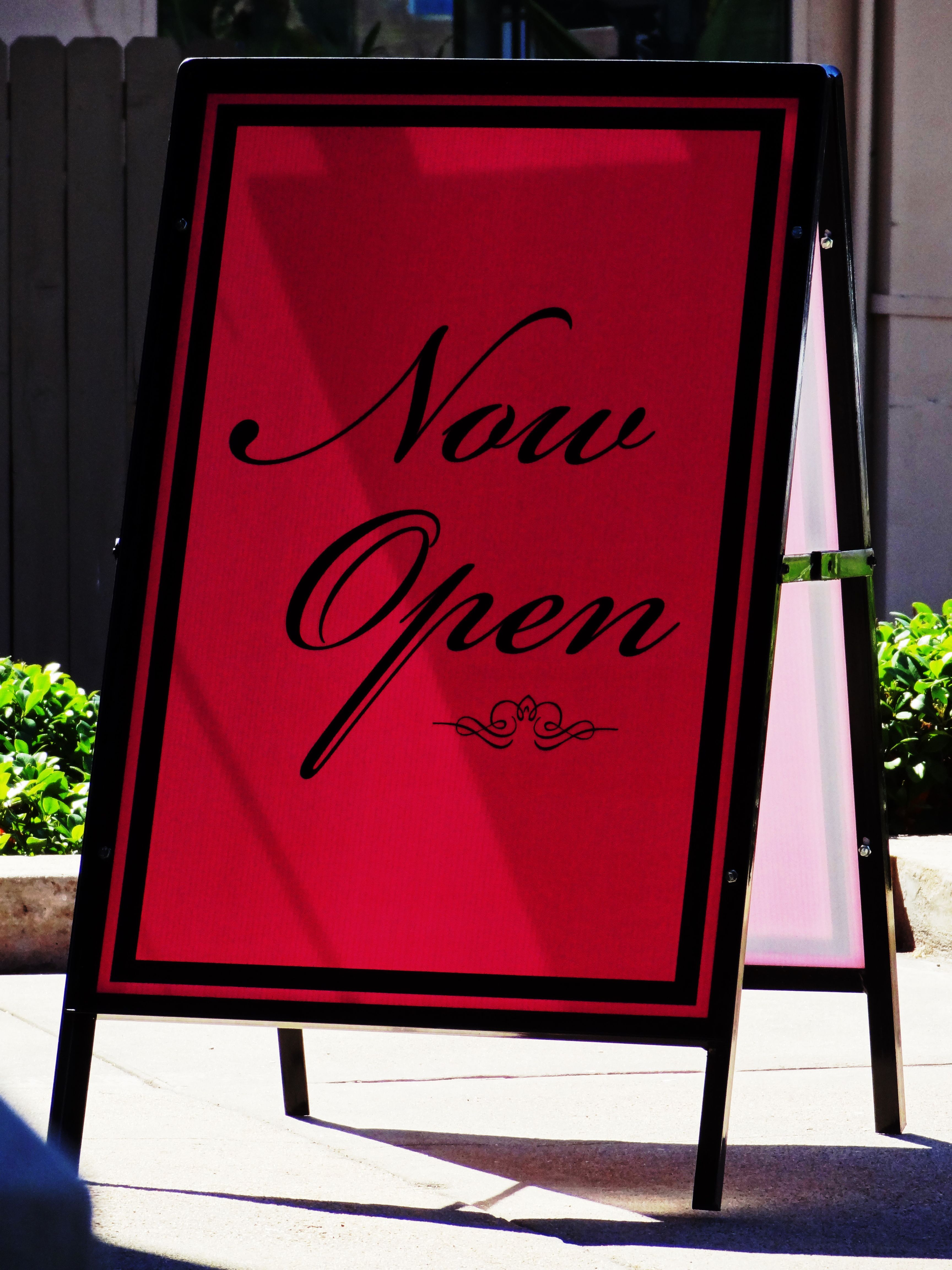 The Now Open sign for Pretty Kitty, a waxing boutique for your ...