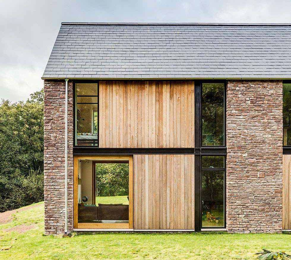 steel frame house clad in stone and timber more