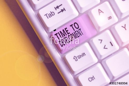 Text sign showing Time To Development Business photo showcasing a length of time during which a company grows or develop White pc keyboard with empty note paper above whi...