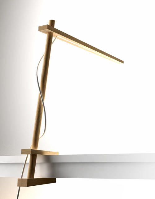 The Clamp Lamp by Pablo Designs: Designed by Dana Cannam for Pablo Designs, the Clamp Lamp uses no fasteners or screws to position itself nicely on the side of your desk. The adjustable head slides up and down the stem and stays in place — just where you like it — without any hardware.