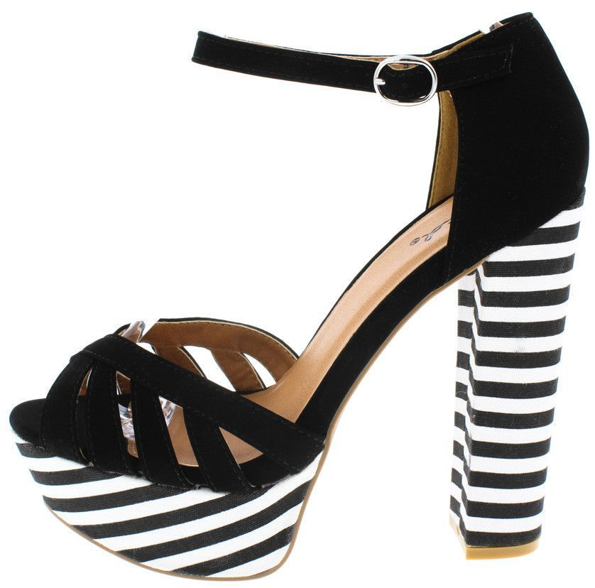 189540532aa8 Features - Ankle strap with a silver buckle - Black and white striped  platform bottom and chunky heel ...