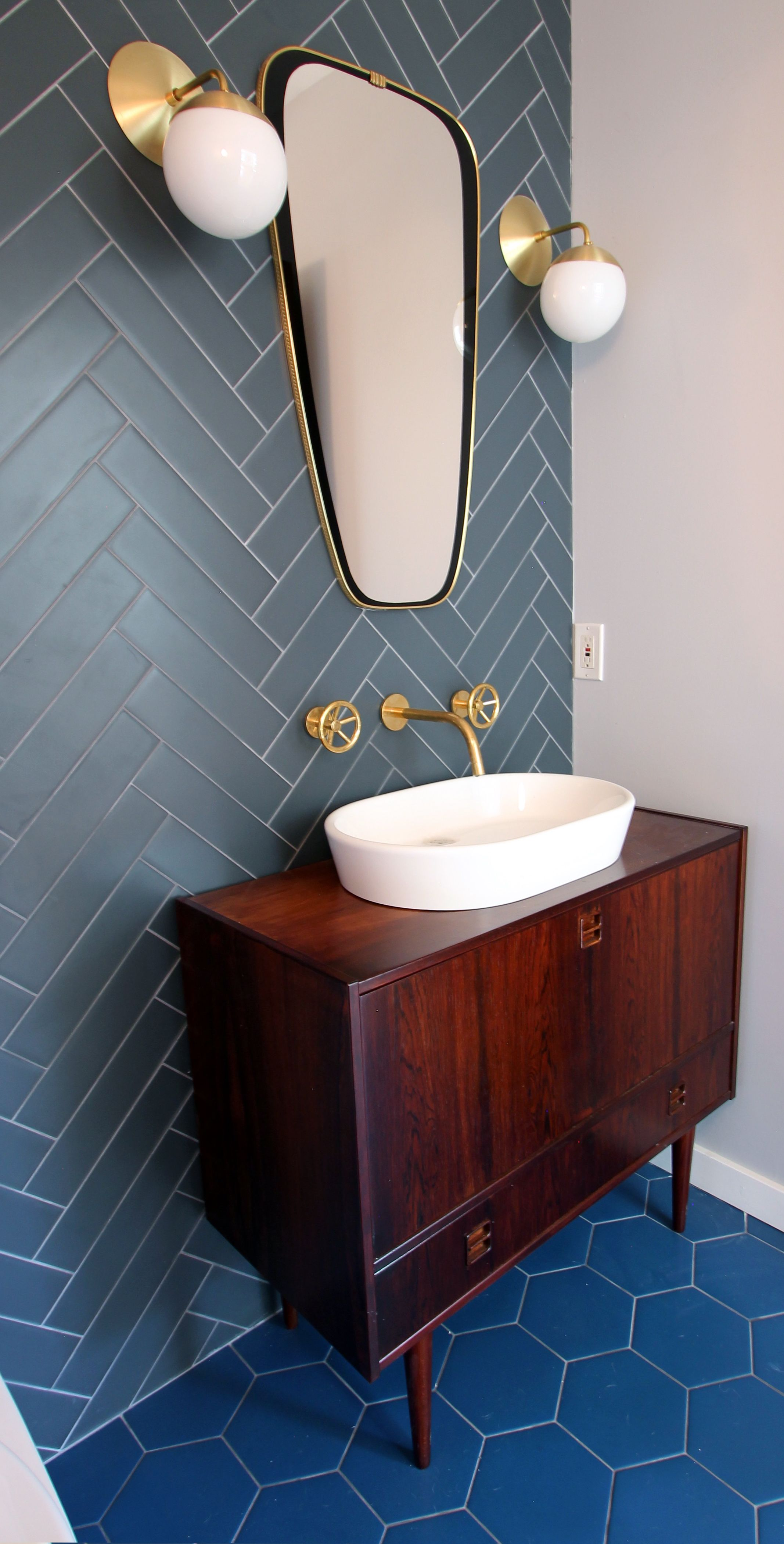 Design and construction project management of a high end powder room featuring a vintage
