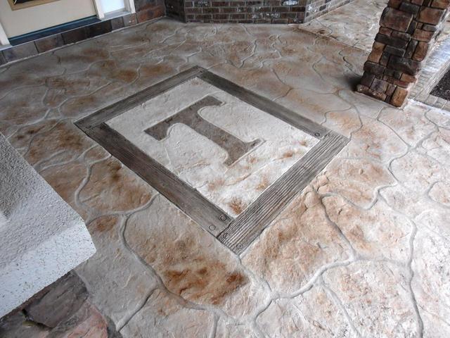 Stamped concrete hardwood floored by design bossier for Hardwood floor concrete stamp