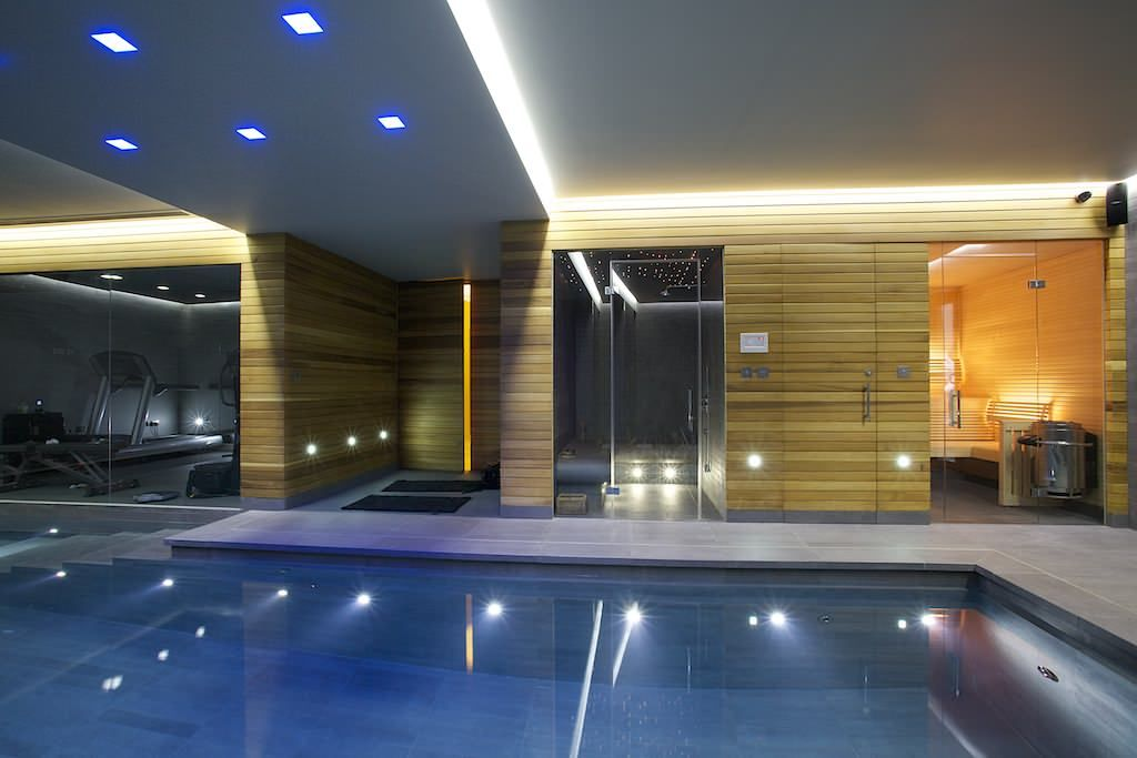 Indoor Pool Grey Tiled Lined Wall Gym Area Home Spa Recessed Lights High  Raised Ceiling Of Getting Inspired By 10 Stunning Ideas Of Modern Swimmingu2026