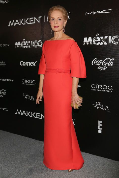 4f60248f01c 18 chicest mother of the bride style icons  Carolina Herrera stands out in  a classic and clean red gown.