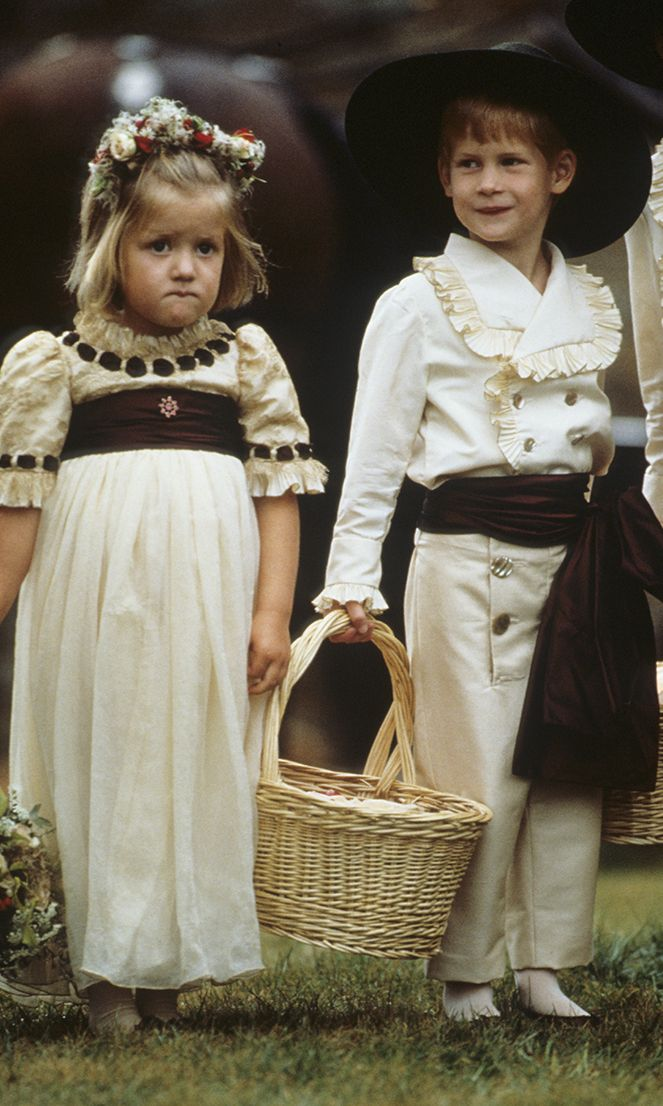 Prince Harry enjoys his role as a pageboy alongside his cousin Eleanor Fellowes at the wedding of his uncle, Viscount Althorp, to Victoria Lockwood on September 17, 1989 in Althorp, England.