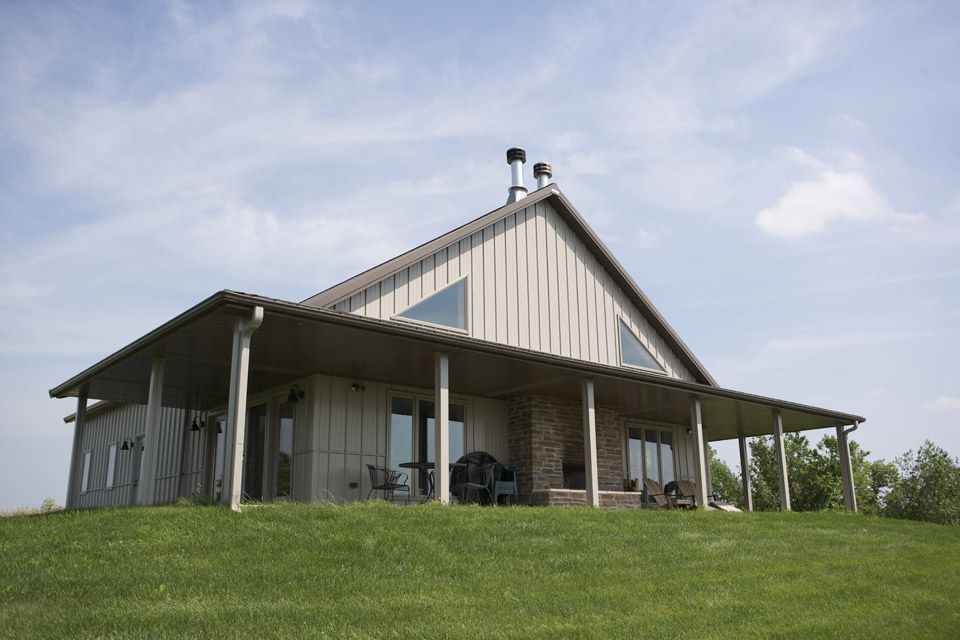 Unique metal building cabin for mid sized family w porch for Metal garage with porch
