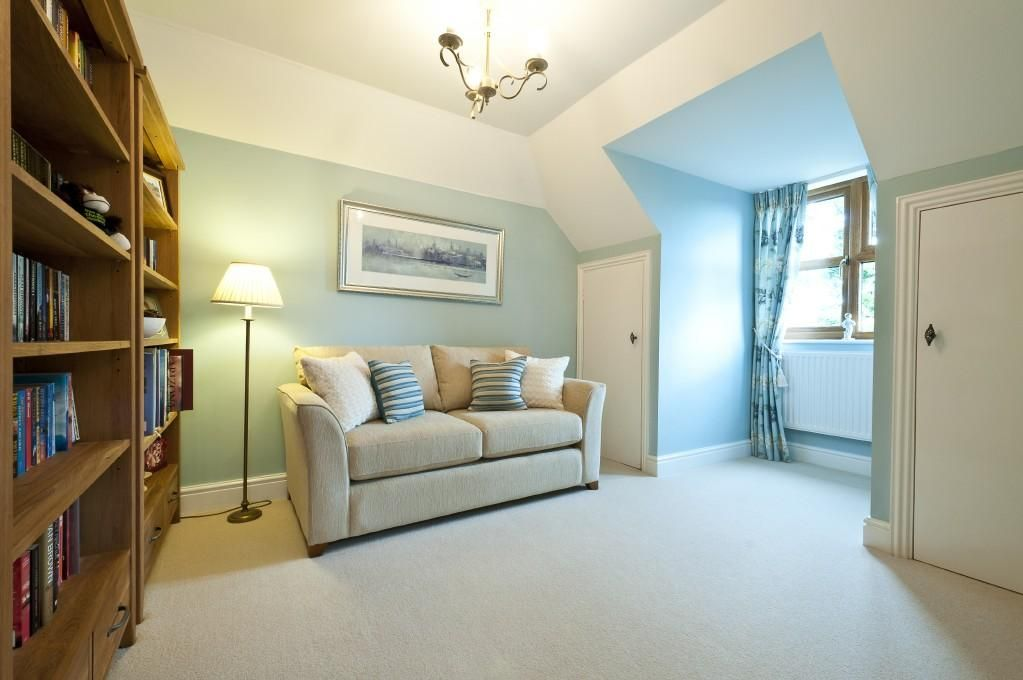 Photo Of Bright Warm Beige Blue Cream Light White Bedroom Living Room With Lighting Cushions Soft Furnishings And Bookshelf