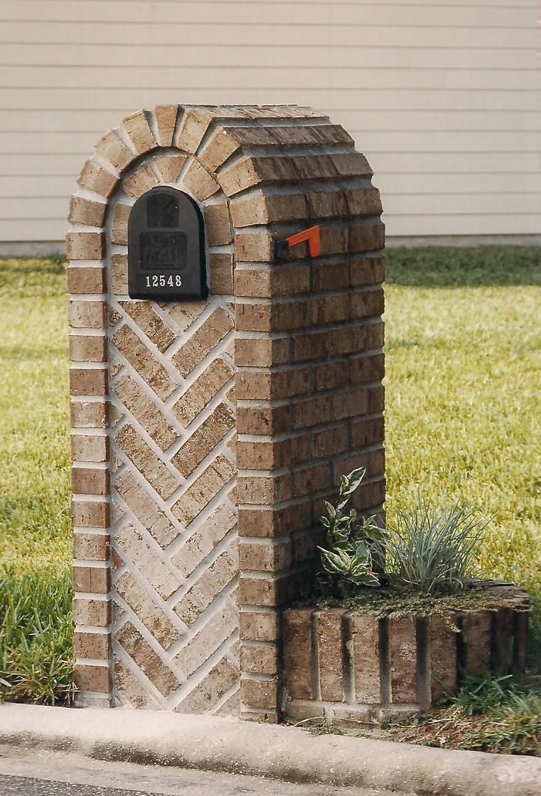 Brick mailbox with herringbone pattern and additional brick planter attached