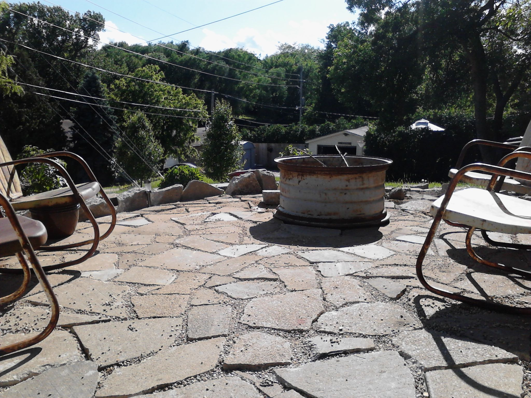 Recycled Concrete Patio   Broken Up Sidewalk Cement Patio, Old Tractor Tire  Fire Ring, Old Metal Chairs