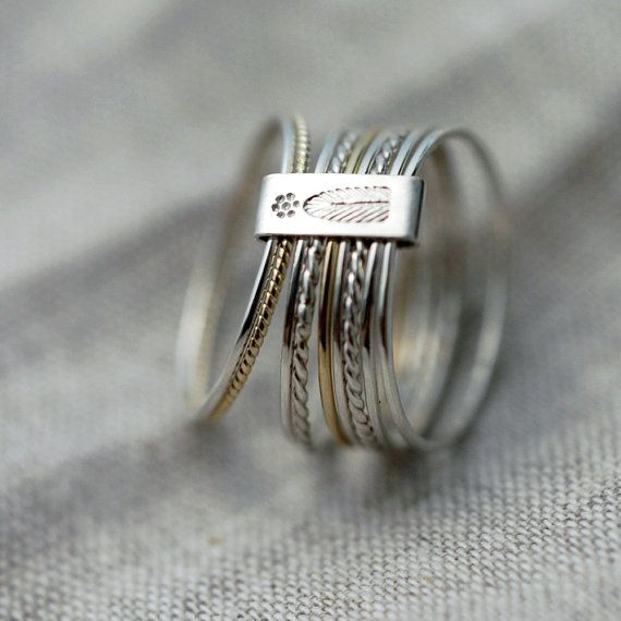 9 Candy twists silver and gold stacking rings from Minicyn. €110.