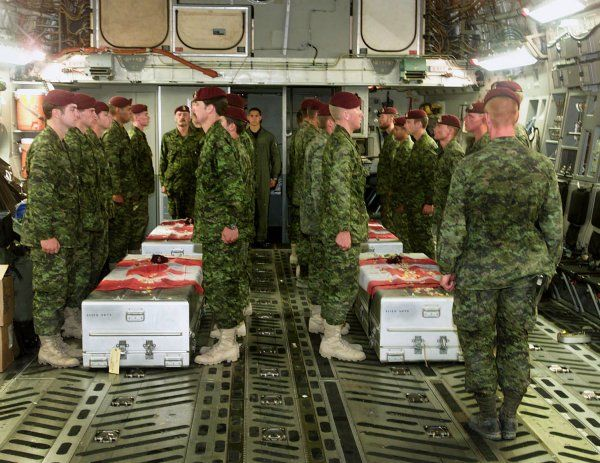 Last Respects – Members of the 3rd Battalion Princess Patricia's Canadian Light Infantry (3 PPCLI) Battle Group pay their last respects aboard a United States Air Force C 17 aircraft to four of their fallen comrades, who were killed in a training accident near Kandahar, Afghanistan. The accident victims were Canadian Forces members serving with the 3 PPCLI Battle Group based out of Edmonton, Alberta. Photo by: Cpl Lou Penney, 3 PPCLI Battle Group