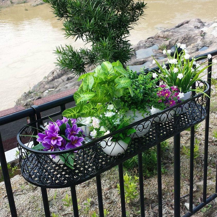 wrought iron railing fence flower pots