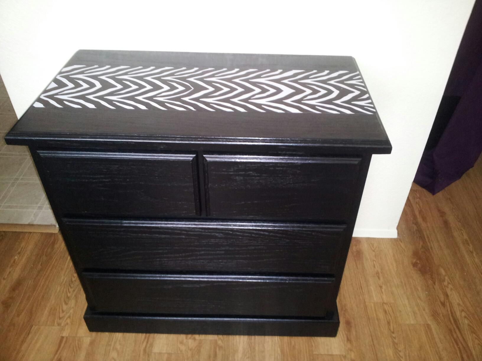 4 drawer dresser has been repainted in a high gloss black paint with