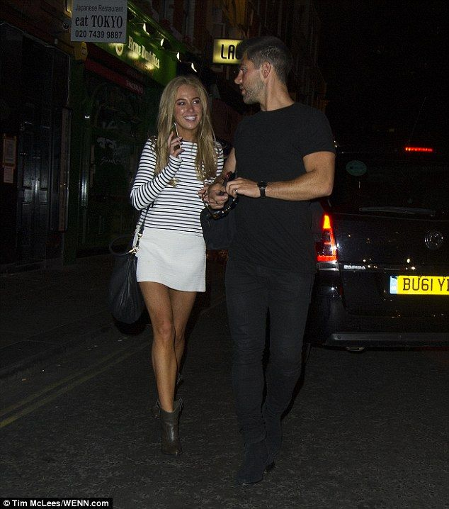 Understated: Nicola kept the look clean and simple, teaming the short design with a navy a...