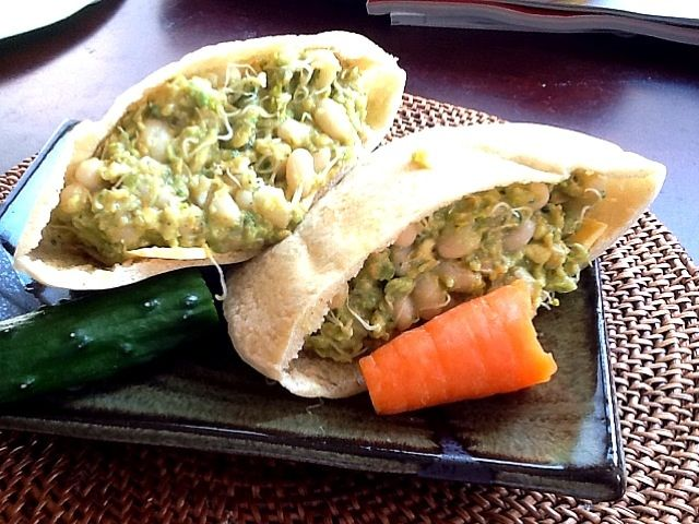 Pita filled with mashed avocado, grated cucumber, carrot