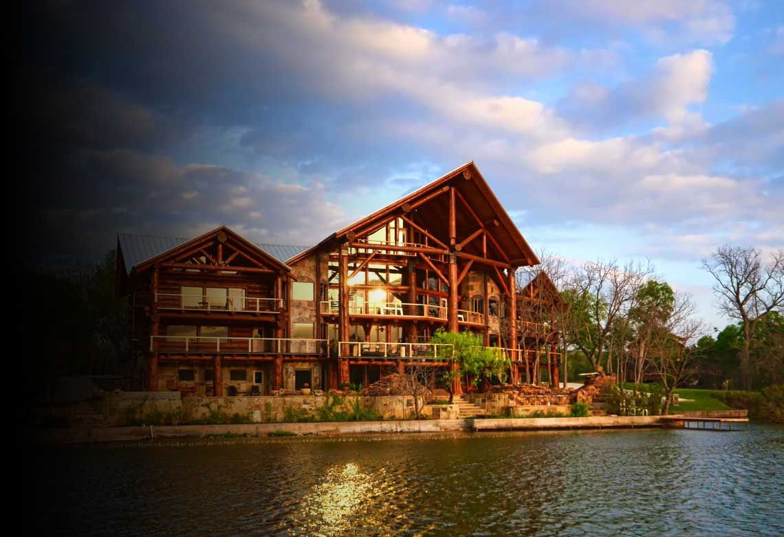 the travis texas vacation on cabin living cabins waters in after floating lake