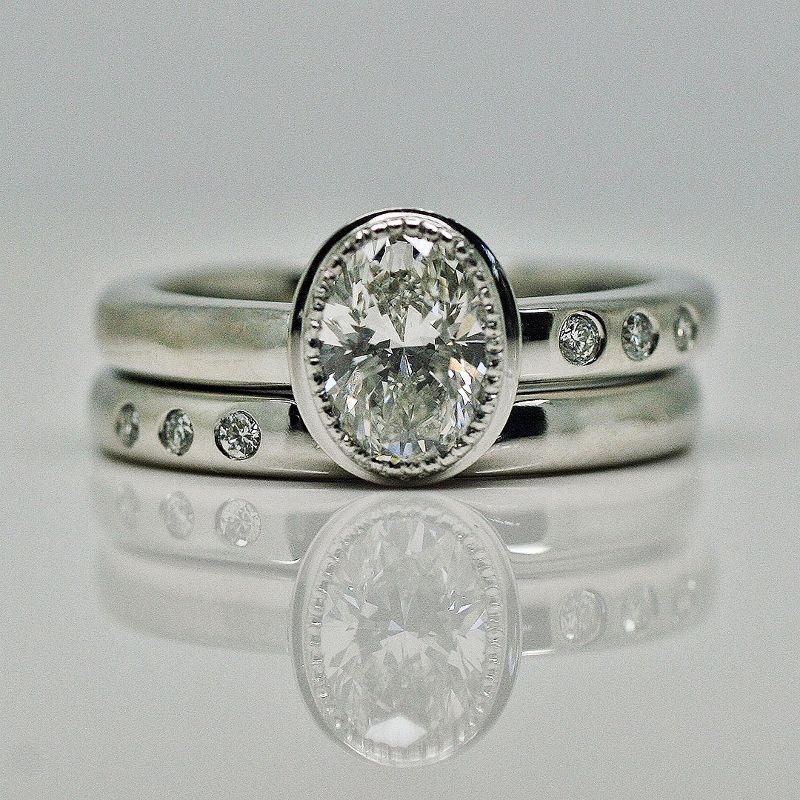 Oval diamond platinum offset ring set Engagement and wedding ring