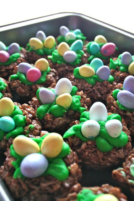Fun Easter food. Coco crispy cereal treats , green frosting and m candy.