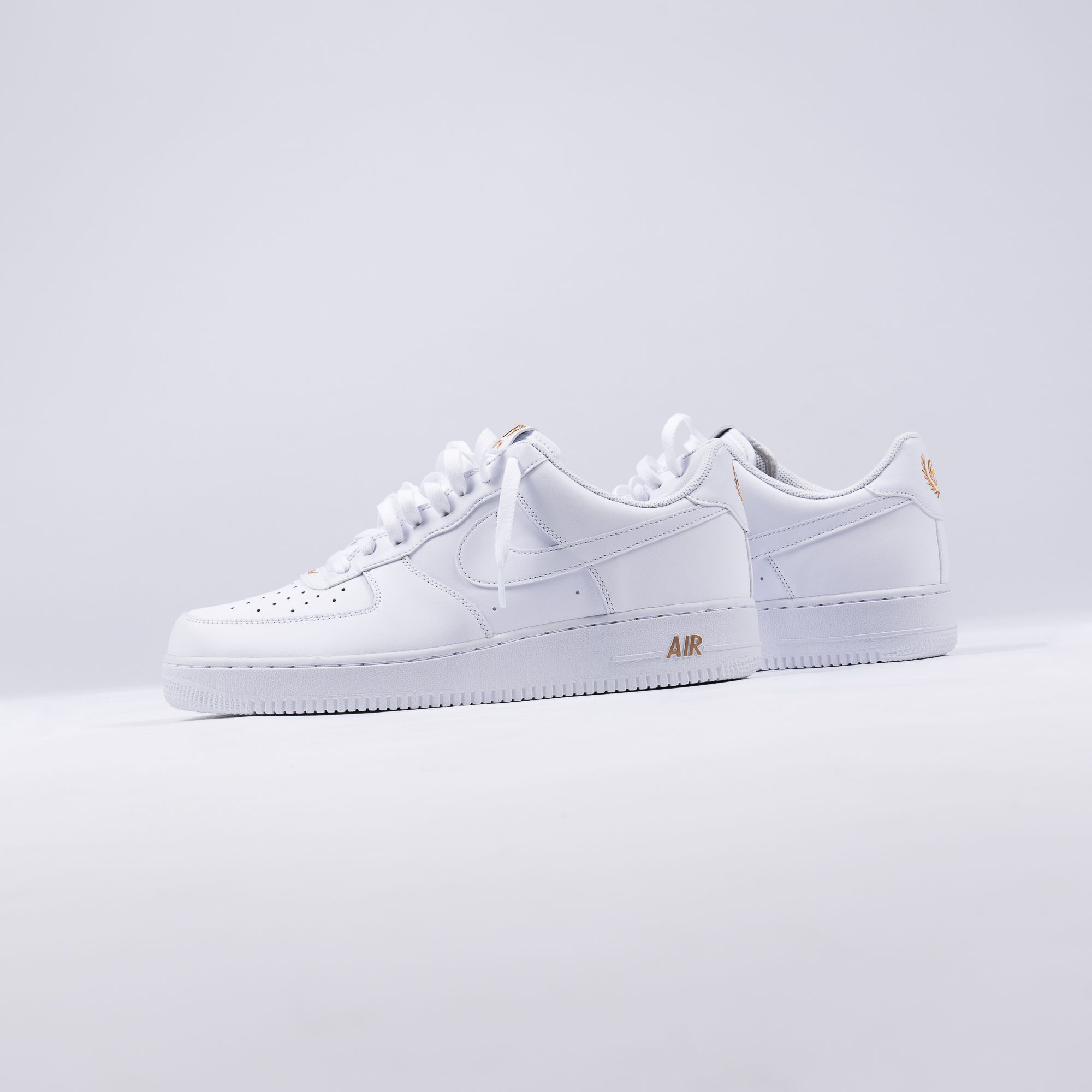 46a53d3a3 Nike s iconic Air Force 1 Low is adding a new Lea Crest logo to its heel.  It s made up of a golden basketball and a swoosh that rest inside the leaf.