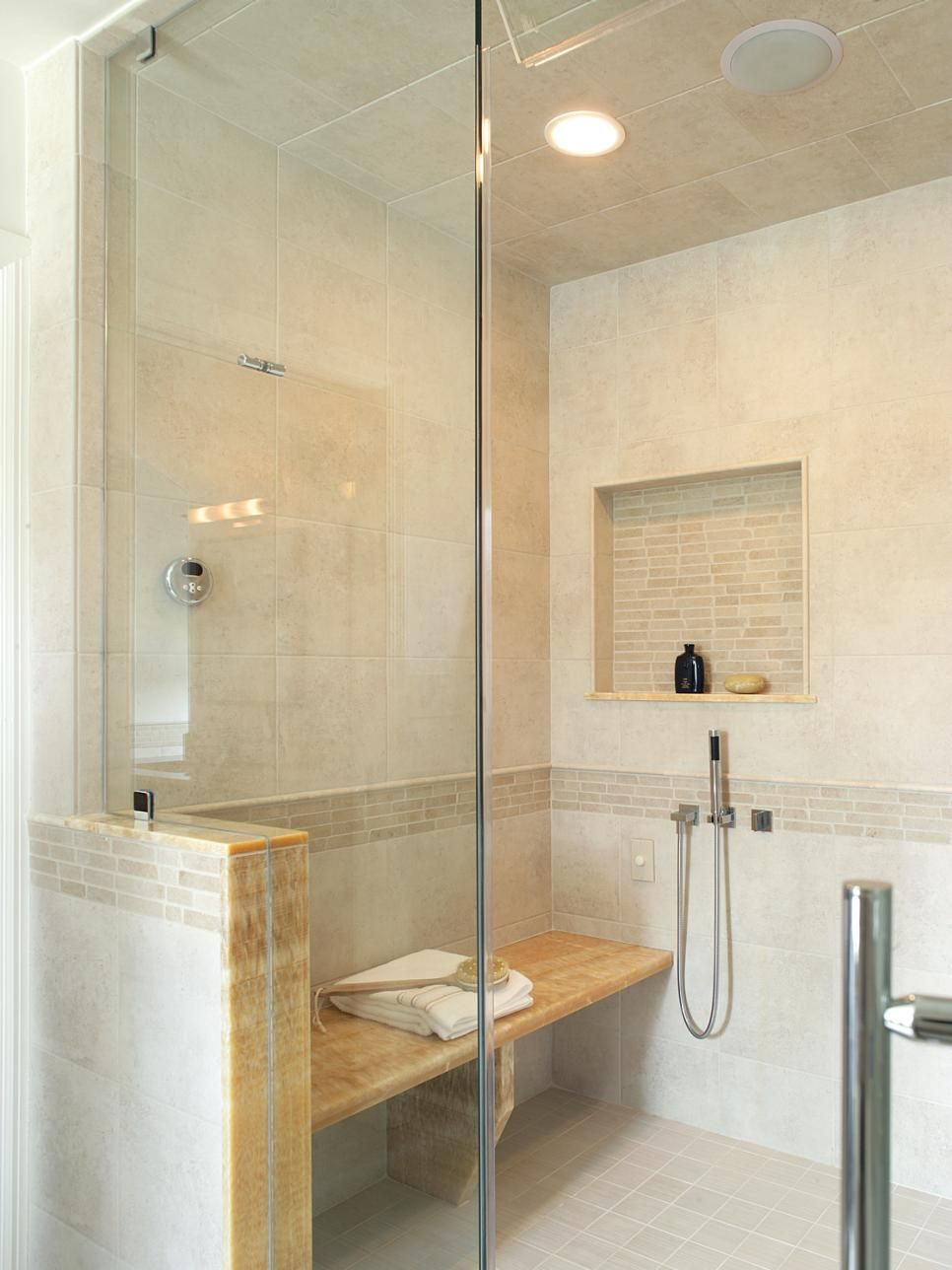 This contemporary master bathroom steam shower features a built-in ...