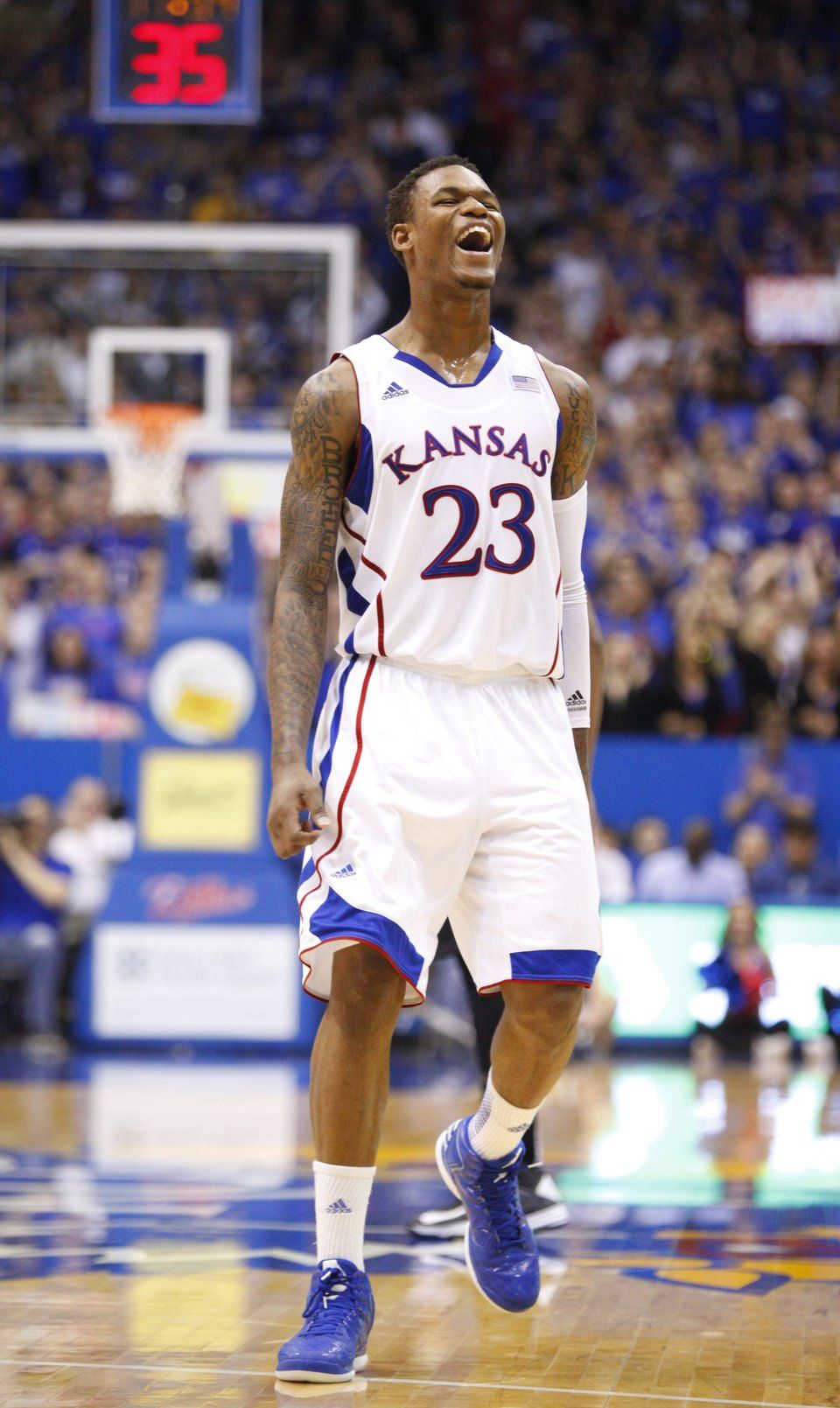 Kansas guard Ben McLemore gets excited after a forced turnover ...