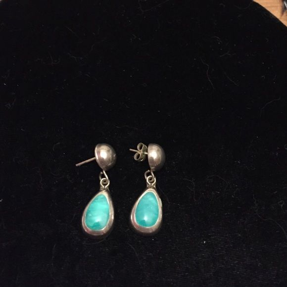 Earrings Turquoise and Sterling silver earrings. Solid earrings were too heavy for me but beautiful earrings. Both pieces have a slight flaw but won't really be recognized when wearing them. Jewelry Earrings