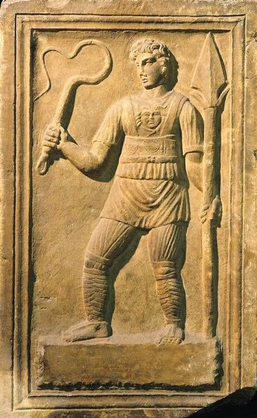 Relief depicting a gladiator holding a whip and a spear. Location: Museo della Civilta Romana, Rome, Italy. Roman, (2nd century AD)