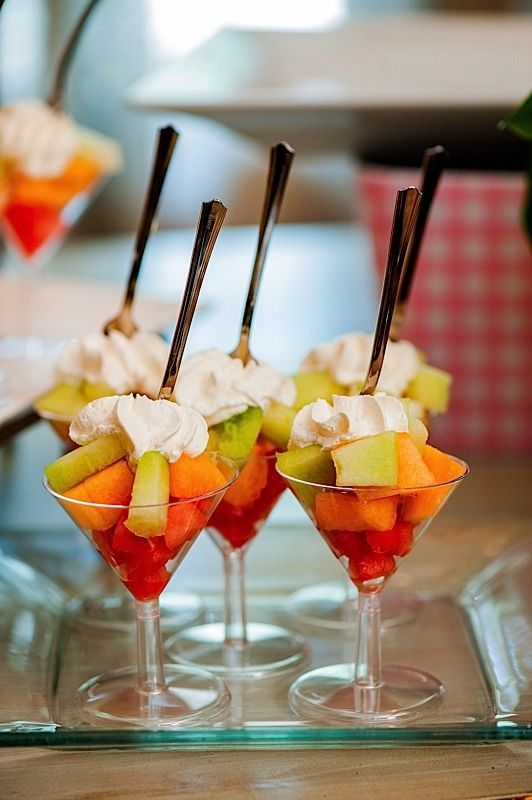 fresh fruit and a dollop of whipped cream served in a martini glassgreat presentation