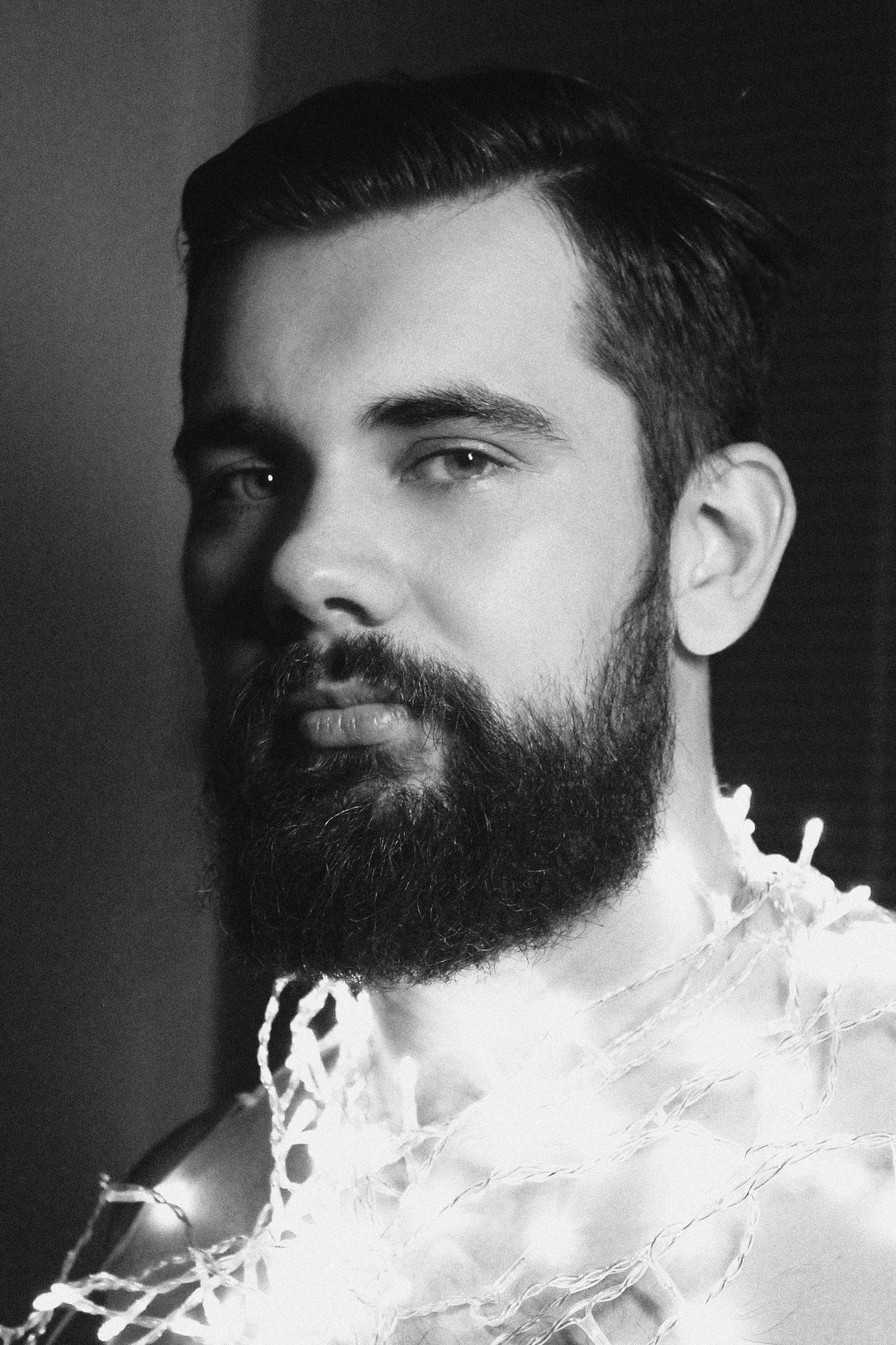 Gorgeous bearded man lights beard model menus hairstyle and