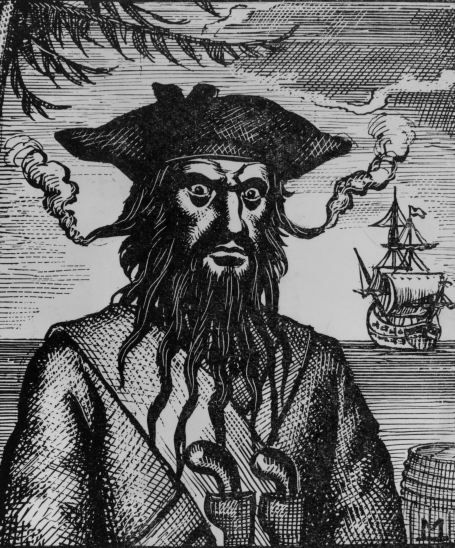 """During battle Edward Teach would place lit, slow burning hemp cords under his hat near his ears that would smoke and envelop him in a cloud. He gave himself the name """"Blackbeard."""""""