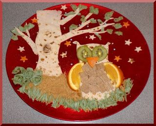 Pancake tree with pancake owl, ginger nut crumbs, oranges, kiwi fruit.