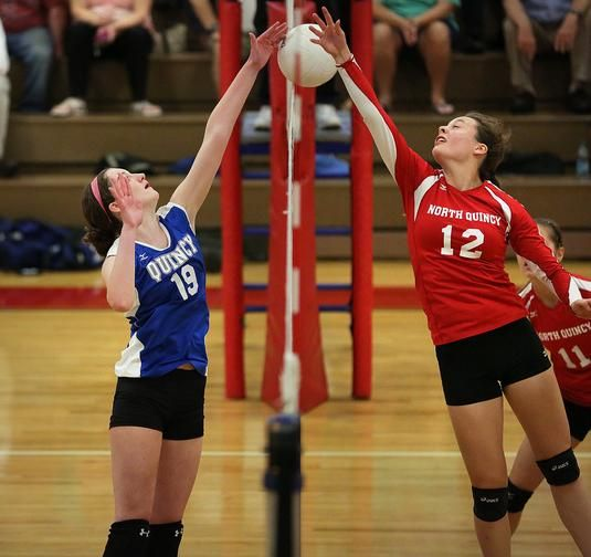 Quincy S Caroline Mcbride Left And North Quincy S Rose Bennett Leap For The Volleyball At The Net North Quincy Hoste Sports Stars Youth Sports Sports Photos